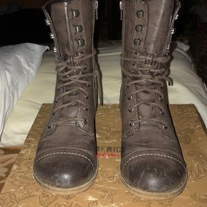 Taupe colored combat boots.